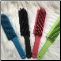 (1) Rubber Bristle Pet Broom/Brush - Colors vary, but you can let us know in the comment box of the order form if you have a preference.